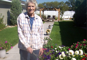 Older Woman Gardening | Assisted Living